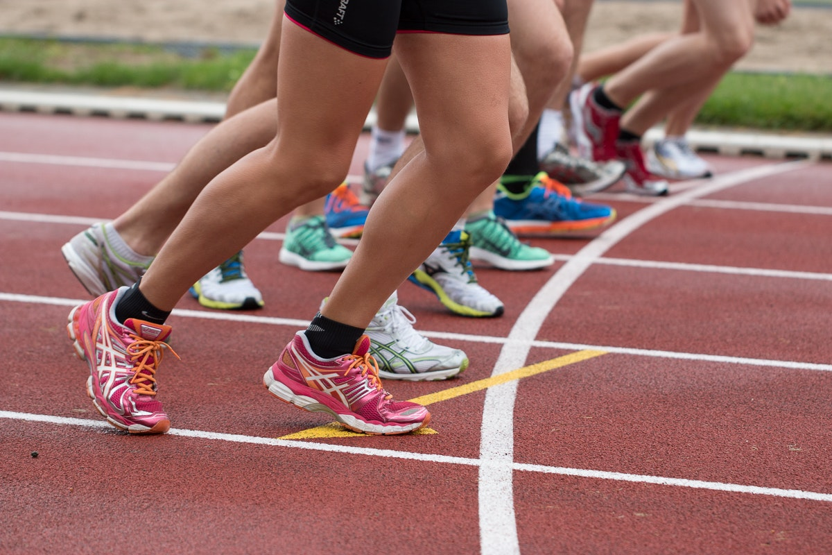 feet in sneakers at a track start