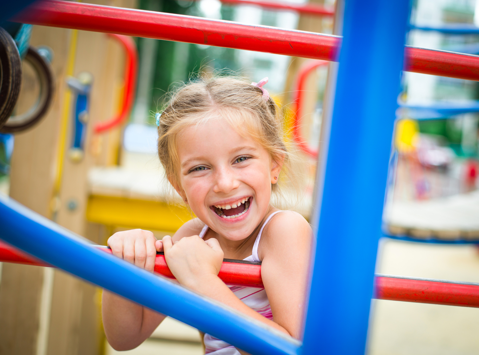 Little girl smiling on playground