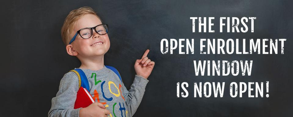 "Little Boy Pointing to Chalk Board - ""Open Enrollment"""